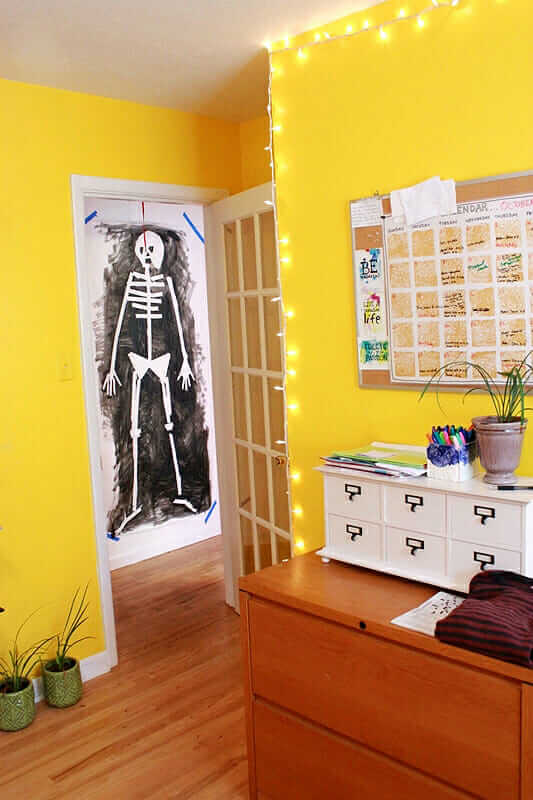 Tape Resist Skeleton Paintings – hanging in hallway