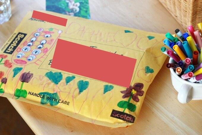 Using Eye Stickers to Decorate Mailing Envelopes