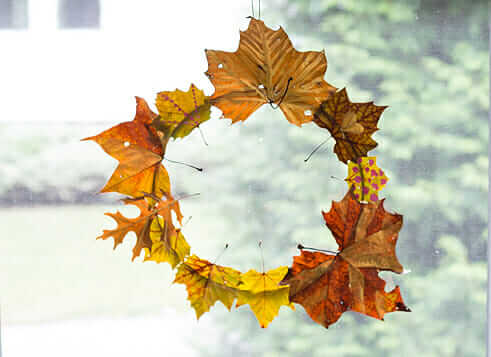 Create This Simple DIY Autumn Leaf Wreath For Fall - finished wreath in window