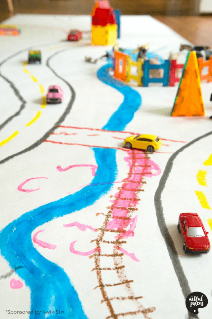 How to make your own play mat for kids with paper and paint sticks