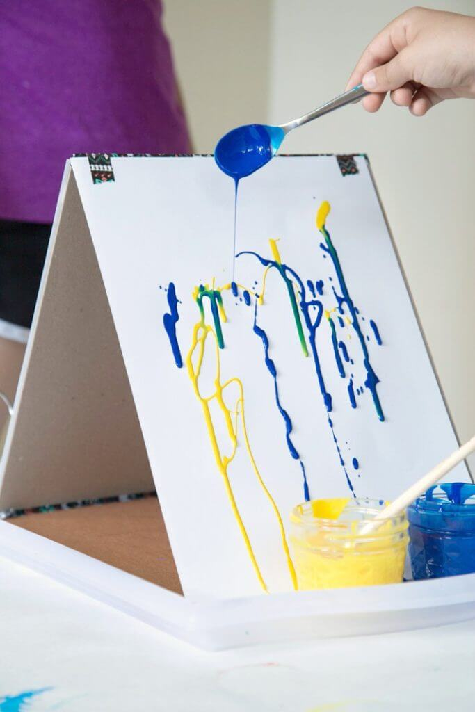 Drip Painting Blue and Yellow Paint on a DIY Cardboard Easel