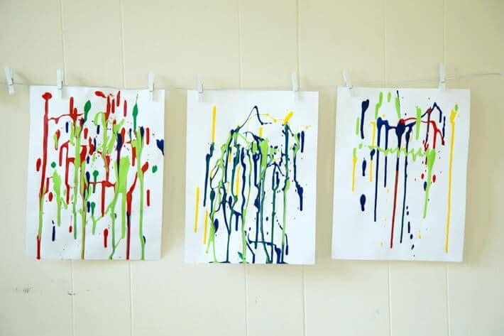Drip Paintings Hanging on Drying Wires