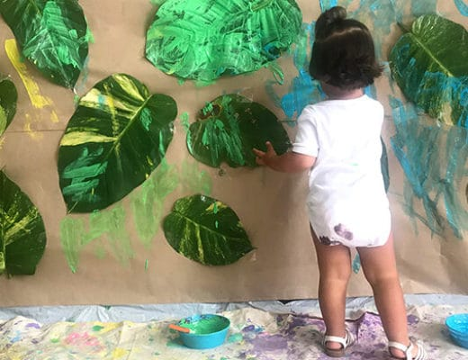 Toddler Art Activities - Painting a leaf wall feature