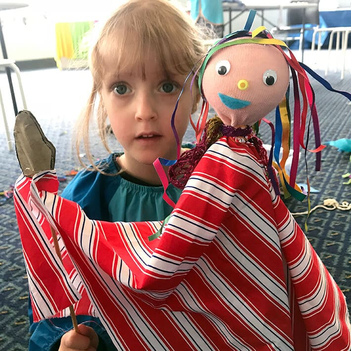 Girl with stick puppet