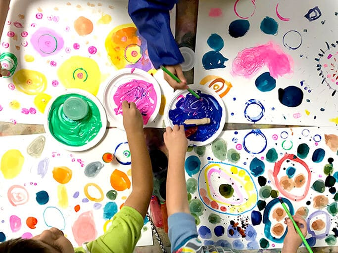 Children painting colorful circles and dots for Yayoi Kusama Inspired Dot Paintingsfor Kids