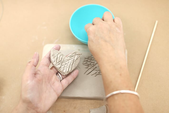 Step 4 – Wetting the piece of clay for clay relief tiles