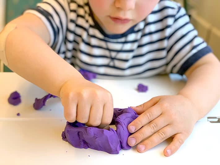 Traveling with toddlers – boy with playdough