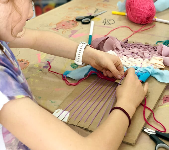 Weaving for kids with yarn and ribbon