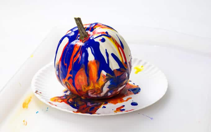 Poured paint over a pumpkin – painted pumpkin ideas for Halloween