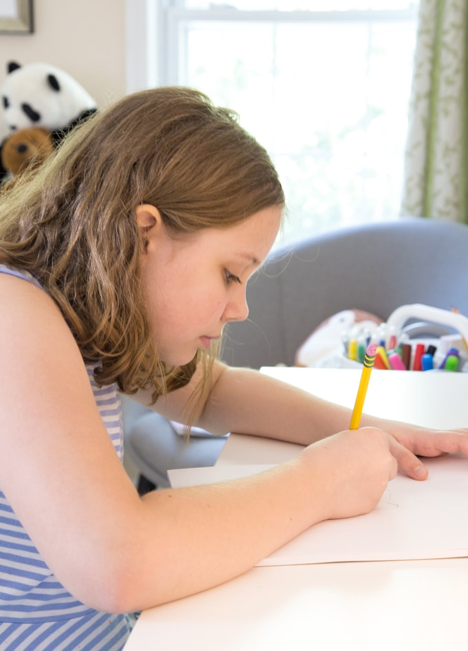 Child drawing at desk